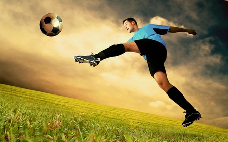 football symbol: Happiness football player on field of sports competition stadium on sunrise sky Stock Photo