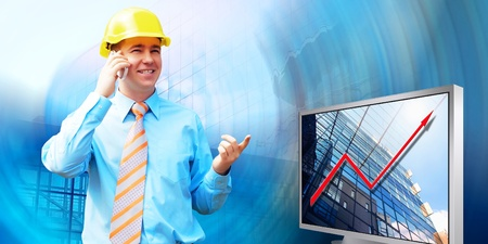 Young architect wearing a protective helmet standing on the building background Stock Photo - 9850955