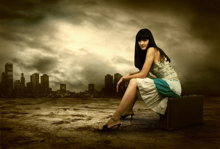 Young woman waiting on the road with her vintage baggage Stock Photo - 9970825