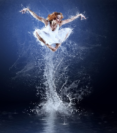 Dancers jump from water with splashes and drops photo