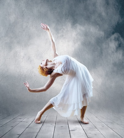 Woman dancer seating posing on background Stock Photo - 9970845