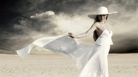 Young beautiful women in white, relaxation at sunny desert photo