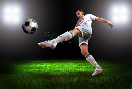 and shoot: Happiness football player after goal on the field of stadium with light