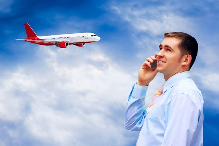 businessmen looks at airplane in air with blue sky  photo