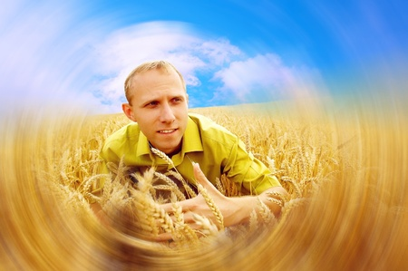 Happiness farmer on the golden wheat field and blue sky photo
