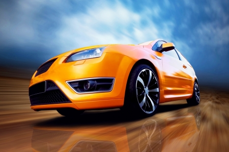 car wheels: Beautiful orange sport car on road