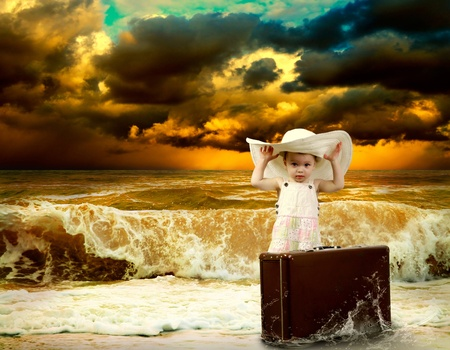 Young child with baggage on the tropical beach Stock Photo - 10049510