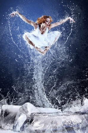 Jump of ballerina on the ice dancepool around splashes of water drops Stock Photo - 10049472