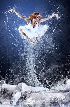 Jump of ballerina on the ice dancepool around splashes of water drops Stock Photo - 10049472
