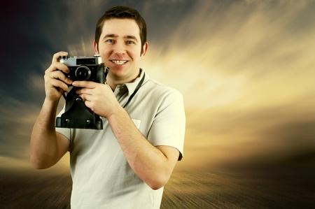 photojournalist: Happiness man with vintage photo camera Stock Photo