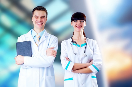 Smiling medical doctor with stethoscope on the hospitals background photo