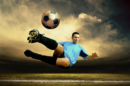 and shoot: Shoot of football player on the outdoor field Stock Photo