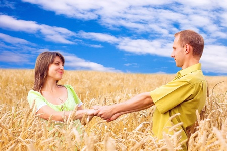 Two happiness people on the golden wheat field  photo