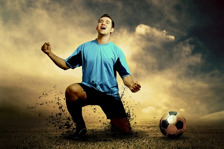 soccerball: Shoot of football player on the outdoor field Stock Photo