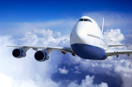 gravity: Airplane at fly on the sky with clouds Stock Photo