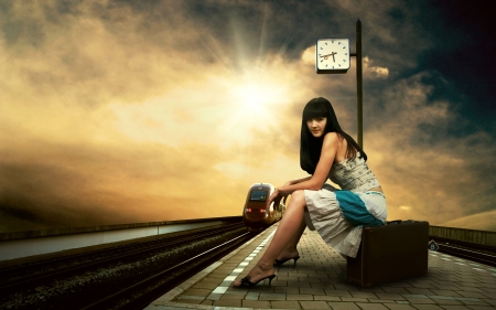 Girl waiting train on the platform of railway station Stock Photo - 10285314
