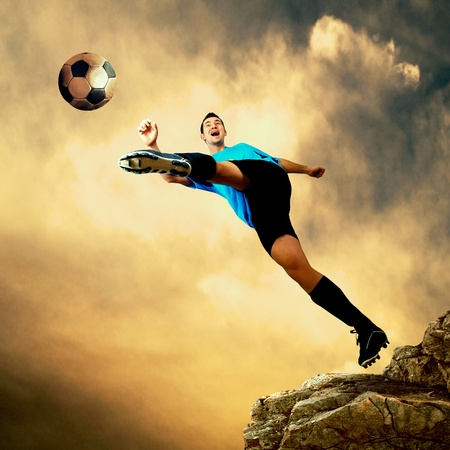 Footballer on the top of mountain photo