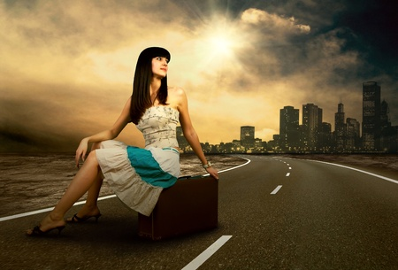 Young woman waiting on the road with her vintage baggage Stock Photo - 10313922