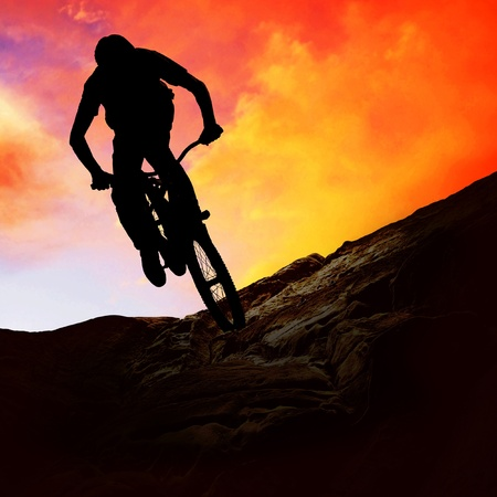 mountainbike: Silhouette of a man on muontain-bike, sunset Stock Photo