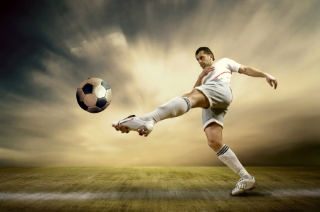 soccer ball on grass: Shoot of football player on the outdoor field Stock Photo