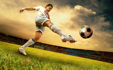 soccer ball on grass: Happiness football player on field of sports competition stadium on sunrise sky Stock Photo