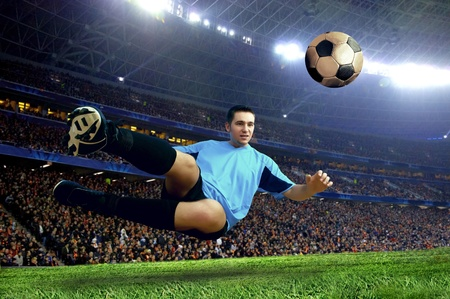 and shoot: Football player on field of stadium