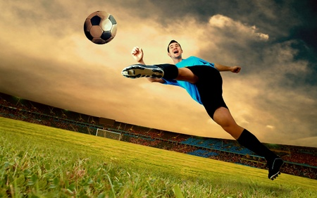 Happiness football player on field of olimpic stadium on sunrise sky photo