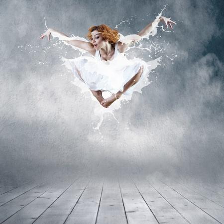 Jump of ballerina with dress of milk Stock Photo - 10521261