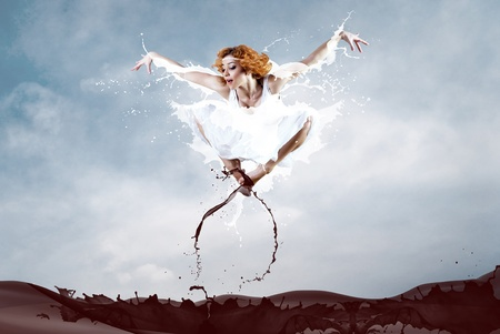 Jump of ballerina with dress of milk Stock Photo - 10521251