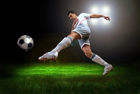 soccer players: Happiness football player after goal on the field of stadium with light