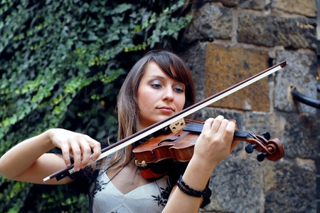Playing violinist on the grunge background photo