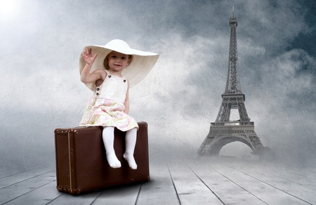 Little girl sitting outdoors on the vintage baggage photo