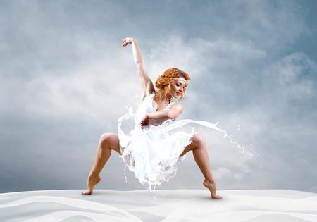 Jump of ballerina with dress of milk photo