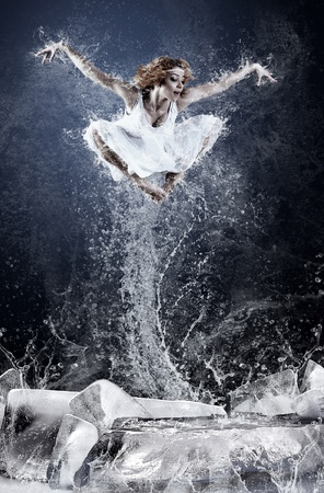 Jump of ballerina on the ice dancepool around splashes of water drops Stock Photo - 10832606