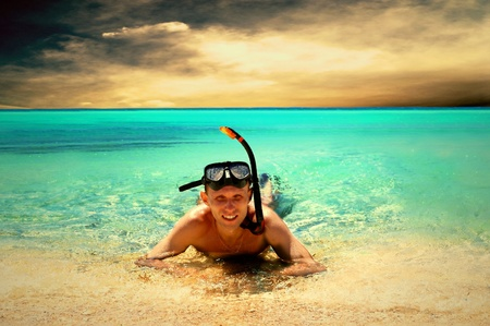 snorkelling: Happy young man with snorkelling on a sea beach