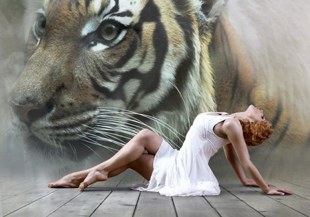 Woman dancer seating posing on wild annimals background  photo