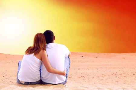 horizon over land: Young couple seating in desert in sunny day
