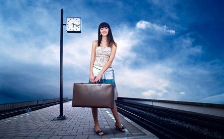 railway station: Girl waiting train on the platform of railway station