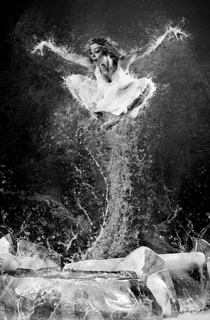 Jump of ballerina on the ice dancepool around splashes of water drops Stock Photo - 11065710