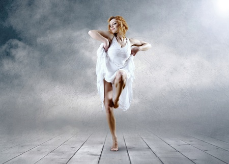 Dance of ballerina with dress of milk photo