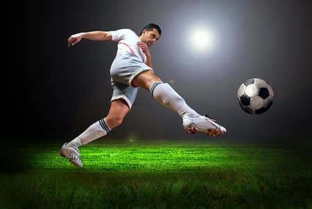 soccer player: Happiness football player after goal on the field of stadium with light
