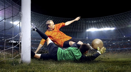 Football player and jump of goalkeeper on the field of stadium at night