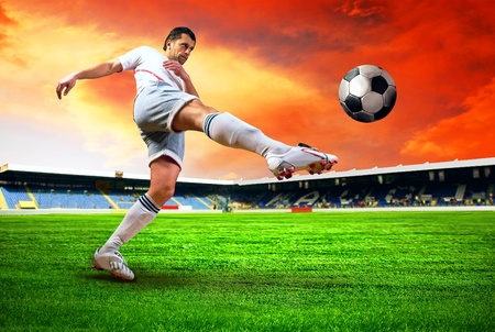 footballer: Happiness football player after goal on the field of stadium with blue sky