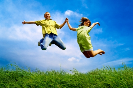 jumping: Fun couple in jump on the outdoor background