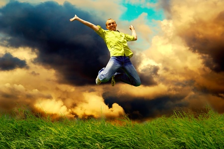 Fun man in jump on the outdoor background photo