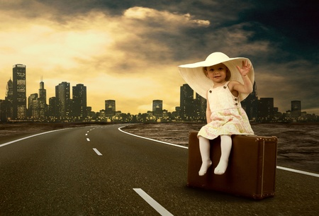 road: Little girl waiting on the road with her vintage baggage Stock Photo