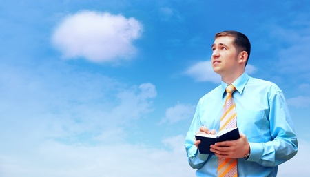 Hasppiness businessman under blue sky with clouds Stock Photo - 12035143
