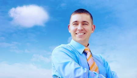 Hasppiness businessman under blue sky with clouds Stock Photo - 12035161