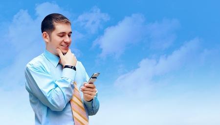 Hasppiness businessman under blue sky with clouds Stock Photo - 12035180