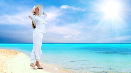 summer clothing: Young beautiful women in the white on the sunny tropical beach Stock Photo